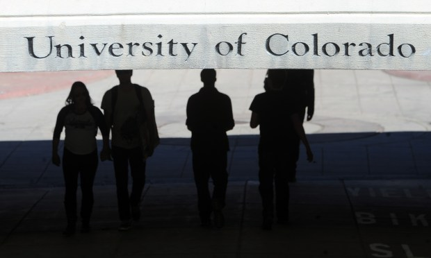 Students walk on the University of Colorado's Boulder campus.