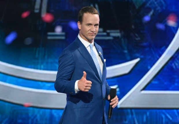 Host Peyton Manning appears on stage ...