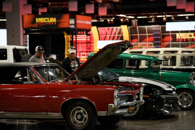 Don Kvasnicka, left, and his father Rick are checking 1967 Pontiac GTO. Mecum Auctions, the world's largest collector-car auction company, returned to Denver at the Colorado Convention Center.