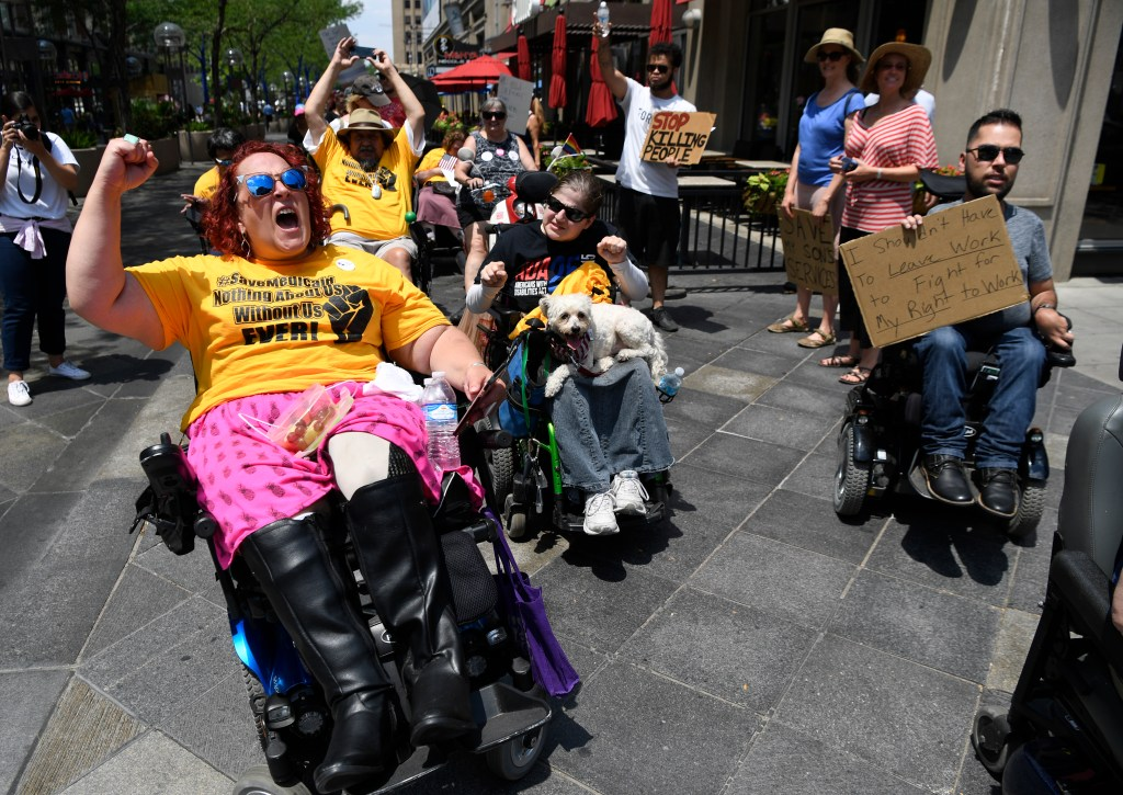 Disabilityrights advocates protest outside Cory Gardners
