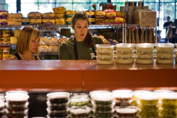 Alison Lueck, right, explains cheeses to ...