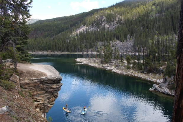 Horseshoe Lake, a favorite of swimmers who sometimes dive off its rocky outcrops, also draws a variety of paddlers to its placid waters.