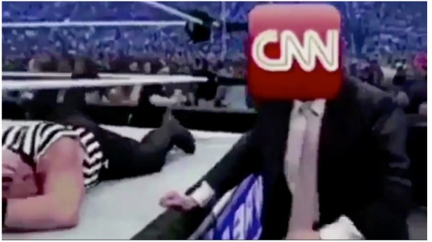 President Donald Trump portrayed himself as wrestling CNN in a doctored photo he tweeted on Sunday.