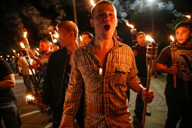 White nationalist groups march with torches through the University of Virginia campus in Charlottesville last Friday evening.