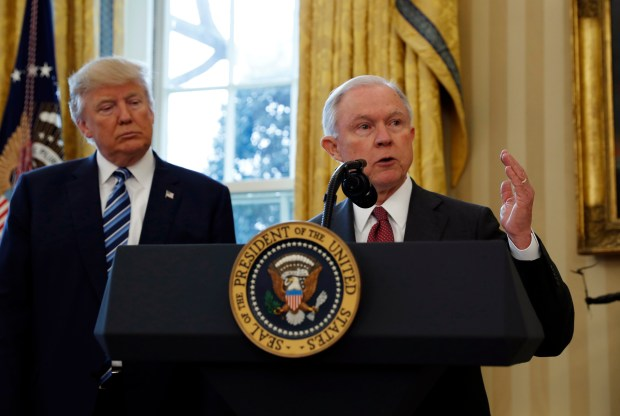 """President Donald Trump listens as Attorney General Jeff Sessions speaks in the Oval Office of the White House on Feb. 9. According to The New York Times, """"The Trump administration is preparing to redirect resources of the Justice Department's civil rights division toward investigating and suing universities over affirmative action admissions policies deemed to discriminate against white applicants."""""""