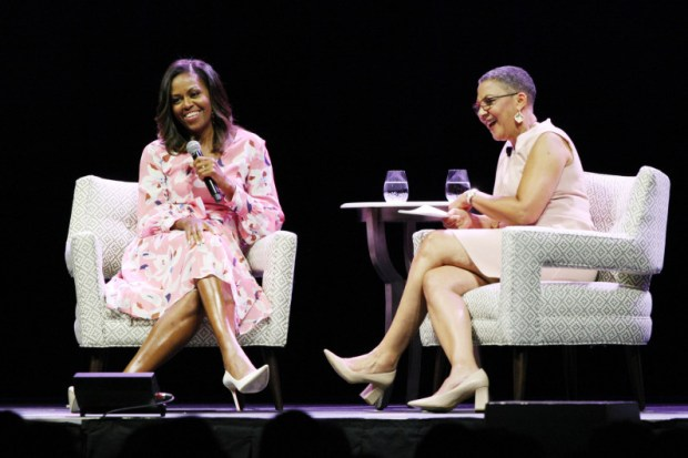 Former First Lady Michelle Obama speaks at the Pepsi Center on July 25, along with Lauren Y. Casteel, president and CEO of The Women's Foundation of Colorado.