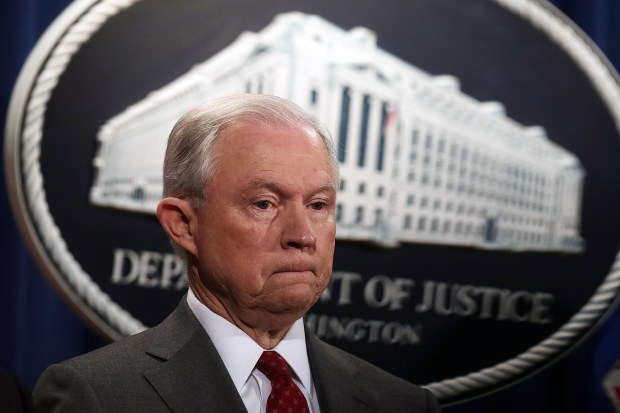 U.S. Attorney General Jeff Sessions pauses during an event at the Justice Department on Friday.