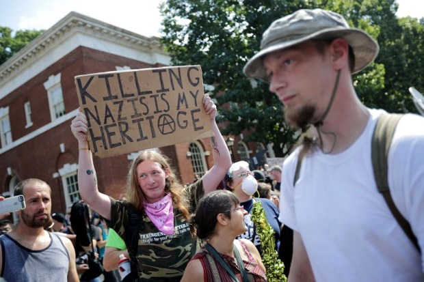 "Counter-protesters line the route taken by white nationalists, neo-Nazis and members of the ""alt-right"" during the Aug. 12 ""Unite the Right"" rally in Charlottesville, Va."