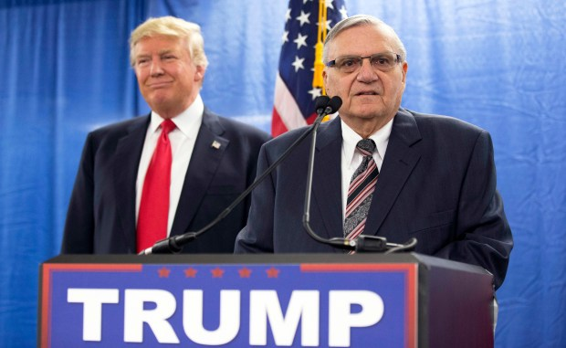 Republican presidential candidate Donald Trump is joined by Joe Arpaio, who was sheriff of metro Phoenix at the time, during a Jan. 26, 2016, news conference in Marshalltown, Iowa.