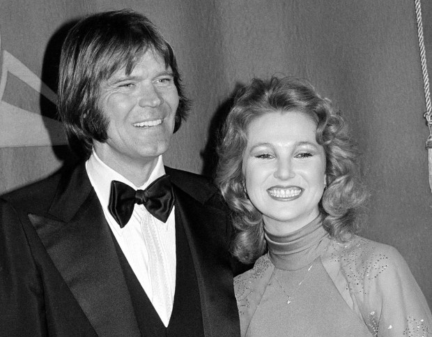 In this Feb. 15, 1979 file photo, country singers Glen Campbell, left, and Tanya Tucker, engaged to one another, are shown at the Grammy Awards in Los Angeles.