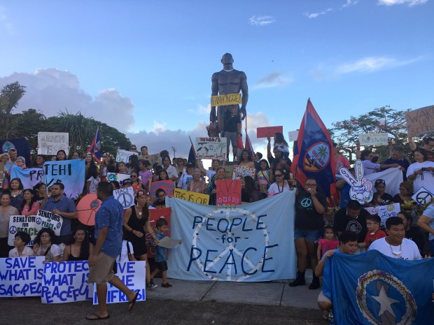 About a hundred people gather at Chief Kepuha Park in Hagatna, Guam for a rally for peace Monday, Aug. 14, 2017. The U.S. territory has been the subject of threats from North Korea in its escalating war of words with the U.S. President Donald Trump's administration.