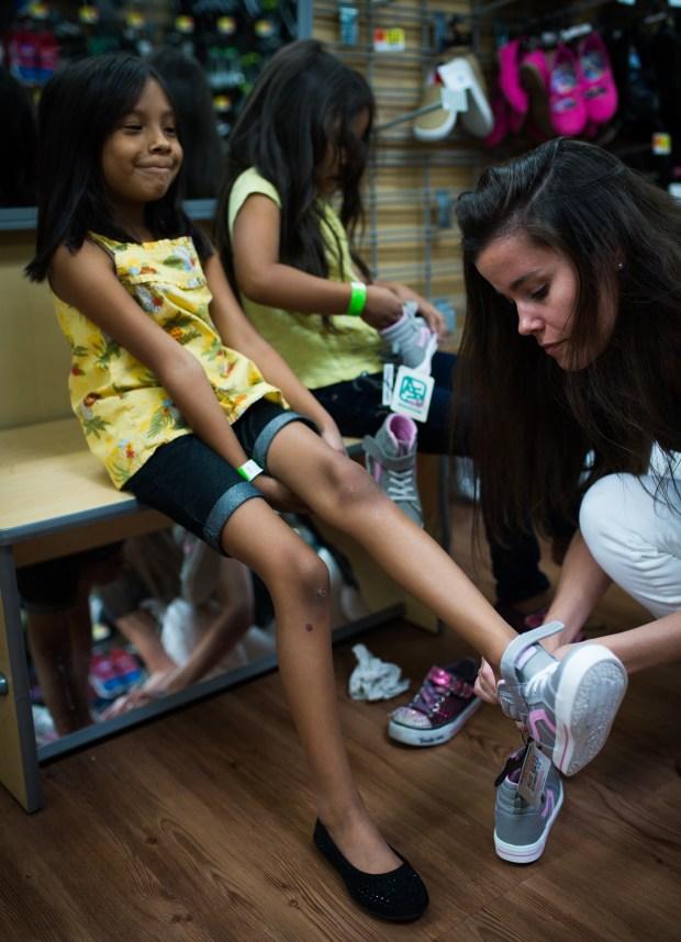 Estrella Romero tries on new shoes ...