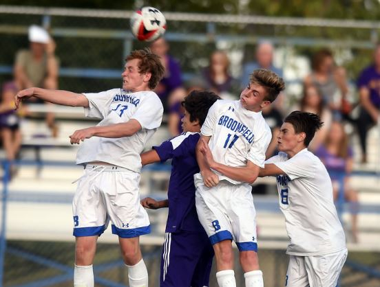 Tanner Smith, left, Broomfield, Ian McDiarmid, of Boulder, Brady O'Dell and Cade Austin, both of Broomfield, on the header.