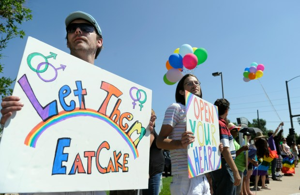 Gay couple Dave Mullins, second from left, and Charlie Craig, left, were joined by a small group of supporters in Lakewood on Saturday, August 4, 2012 to protest and boycott the Masterpiece Cakeshop at 3355 S. Wadsworth Blvd.