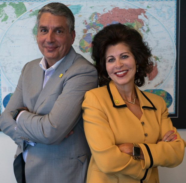 Jacobs Chairman and CEO Steve Demetriou poses with CH2M Chairman and CEO Jacqueline Hinman at CH2M's Denver-area headquarters today.