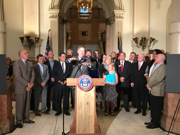 At an event inside the Capitol building, Gov. John Hickenlooper, Parker Mayor Mike Waid and others joined Redbarre CEO Don Levy in touting the proposed Redbarre Digital Media & Technology Campus.