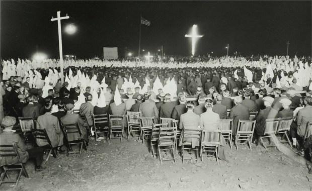 This undated photo shows crosses burning ...