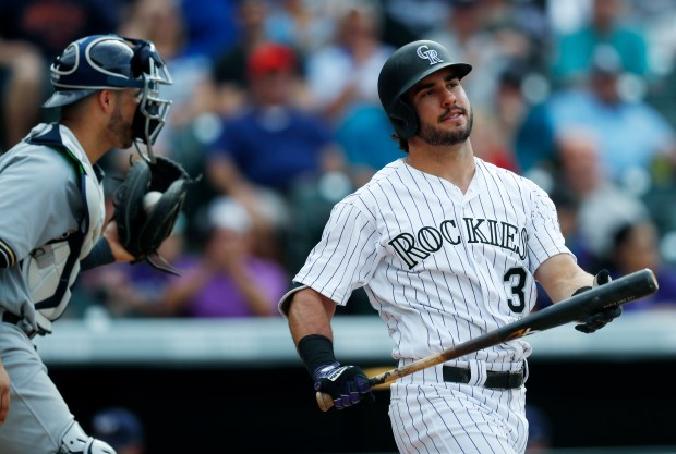 Colorado Rockies pinch-hitter Mike Tauchman, right, ...