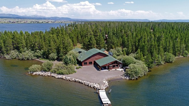 Yellowstone National Park: The 1985 log cabin home on Hebgen Lake is listed at $2,450,000.