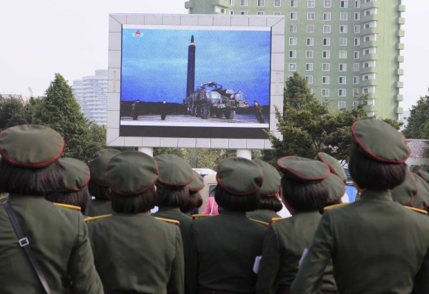 North Koreans watch a televised news broadcast of the test-fire of a ballistic rocket Wednesday in Pyongyang, North Korea. On Tuesday, North Korea fired an intermediate-range missile directly over Japan -- the type of missile that could reach American, South Korean and Japanese military bases in northeast Asia.