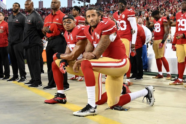 San Francisco 49ers players Eric Reid and Colin Kaepernick kneel in protest during the national anthem prior to playing the Los Angeles Rams at Levi's Stadium in Santa Clara, Calif., on Sept. 12, 2016.