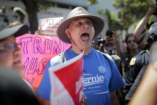 A supporter of Sen. Bernie Sanders yells at a Donald Trump supporter at Martin Luther King Jr. Park in Berkeley, Calif., on Aug. 27.