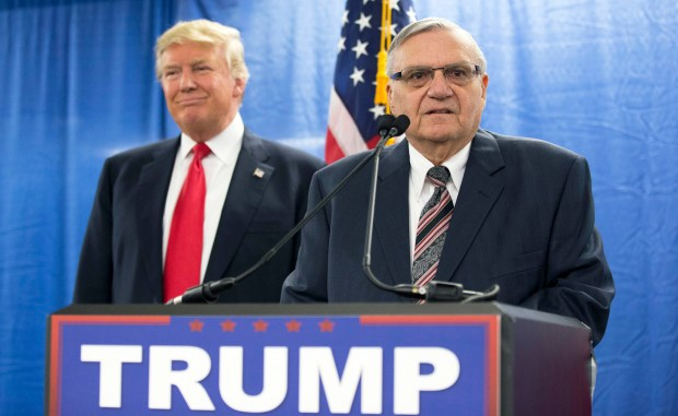 FILE - In this Jan. 26, 2016, file photo, then-Republican presidential candidate Donald Trump is joined by Joe Arpaio, the then sheriff of metro Phoenix, during a news conference in Marshalltown, Iowa. The former Phoenix-area sheriff who was pardoned by President Donald Trump from his federal contempt-of-court conviction in an immigration case is experiencing a wobbly return to the public speaking circuit. In Las Vegas, security concerns prompted event planners to move Arpaio's scheduled weekend appearance to an undisclosed location away from the casino-lined Strip tourist district. (AP Photo/Mary Altaffer, File)