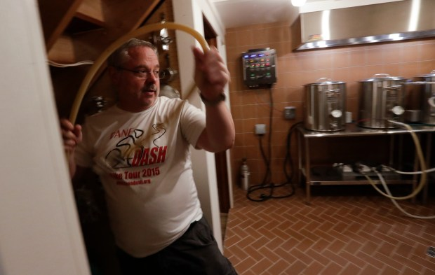 Steve Clemens works on a batch of beer in his home basement brewery in Lodi, Wis. For many home brewers, having a dedicated space for brewing is both practical and fun and creating such a space requires some creativity.