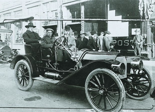 "Damon Runyon sits in the front passenger seat of a vehicle outside The Denver Post building in 1901 at 1548 Champa St. Runyon was fired by The Post five years later, reportedly for allowing a prostitute to type a story on his behalf while he was ""indisposed."""