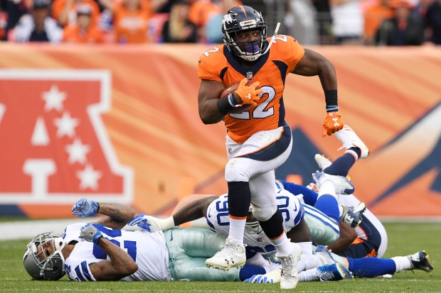 C.J. Anderson (22) of the Denver ...