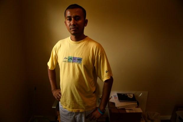 Shoeb Babu, of Dhaka, Bangladesh, poses ...