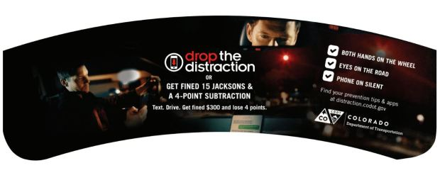 "Cup sleeves warning you off of texting and driving -- one of the most common causes of distracted driving -- will be handed out at 70 metro Denver coffee shops as part of CDOT's ""Drop the Distraction"" campaign that launched this week."