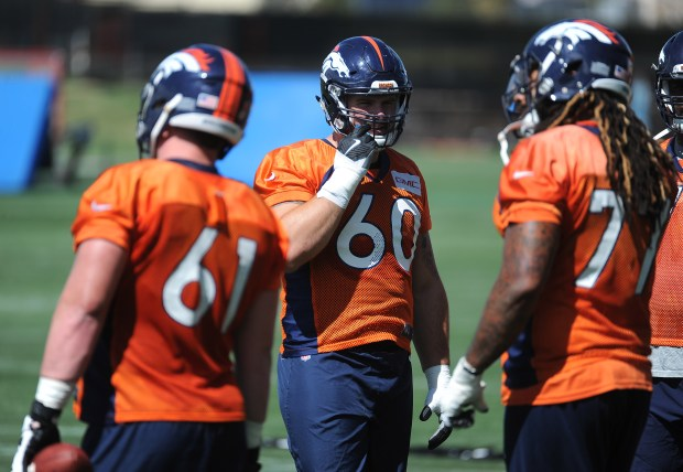 Denver Broncos guard Connor McGovern flanked ...
