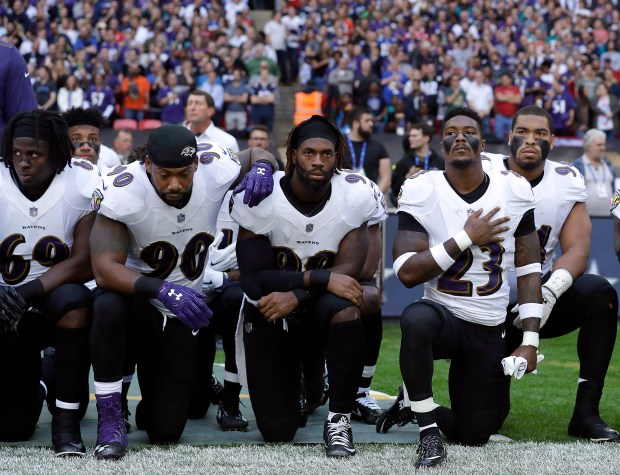 Baltimore Ravens players kneel during the playing of the U.S. national anthem before Sunday's game against the Jacksonville Jaguars at Wembley Stadium in London.