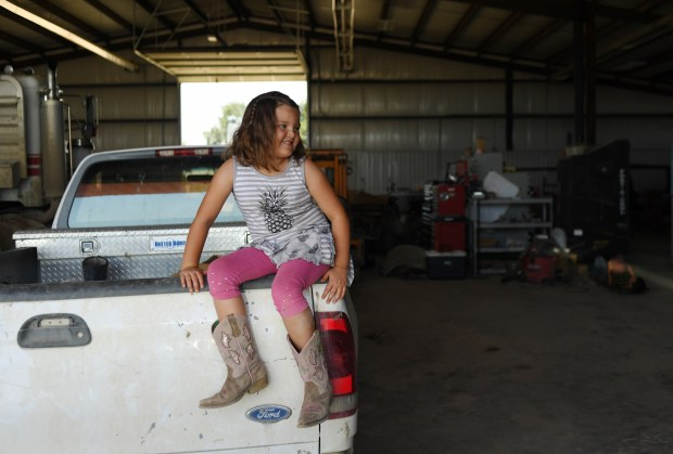 Trista Tomky, 6, sits on the ...