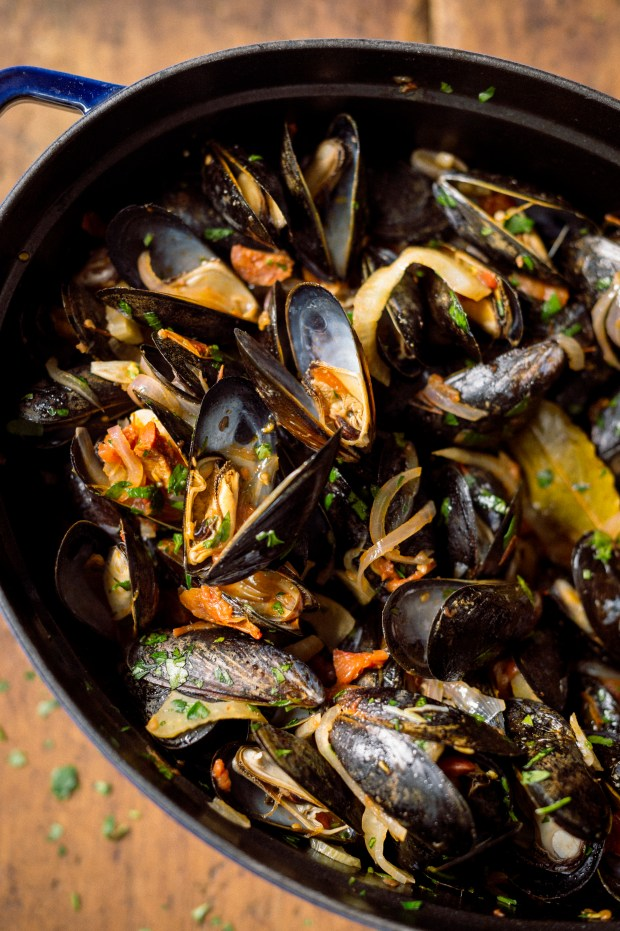 """Mussels with Chorizo and Slow-Roasted Tomatoes from """"Milk Street: The New Home Cooking,"""" by Christopher Kimball."""