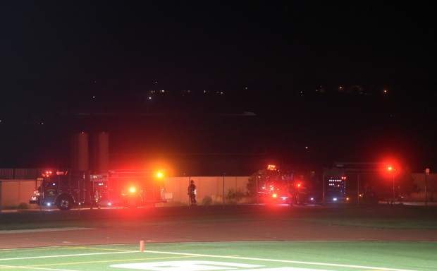 Firefighters clear the field at District 6 Stadium as they investigate a suspected gas leak. The game was cut short as a result of the investigation.