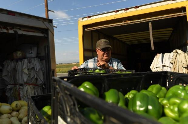 Joe Miller works loading produce at his farm on Sept. 1, 2017 in Platteville.