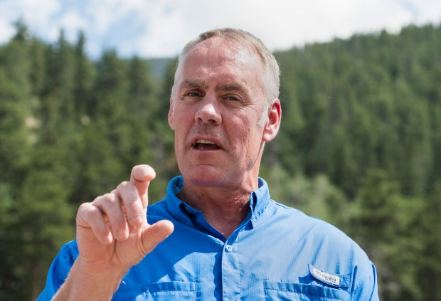 U.S. Secretary of the Interior Ryan Zinke gestures during a July 22 press conference in Colorado's Rocky Mountain National Park. The Trump administration wants to significantly raise entrance fees to some of the country's most popular national parks during peak seasons.