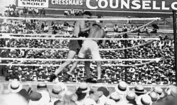 Jess Willard (left) in action against Jack Dempsey during their world heavyweight title fight at Toledo, Ohio, on July 4, 1919. Dempsey won the fight at the end of the third round after Willard's second threw in the towel, and he held onto the title until 1926.