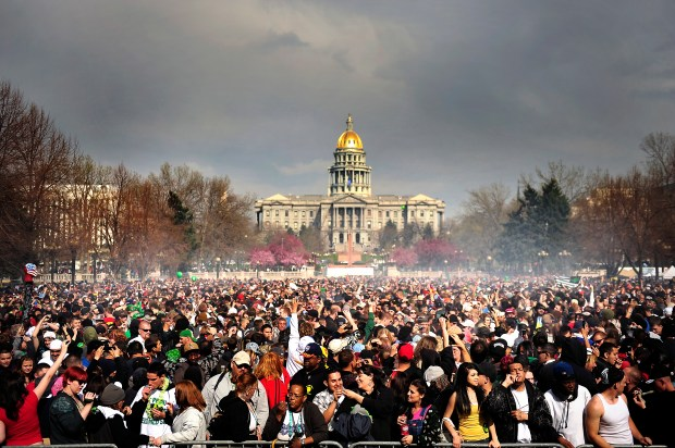 A cloud of smoke covers the crowd at 4:20 p.m. at the Annual Denver 420 Rally in Civic Center Park April 20, 2012.