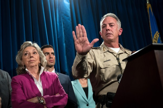Clark County Sheriff Joe Lombardo briefs reporters Tuesday on the ongoing investigation into Sunday night's mass shooting in Las Vegas.