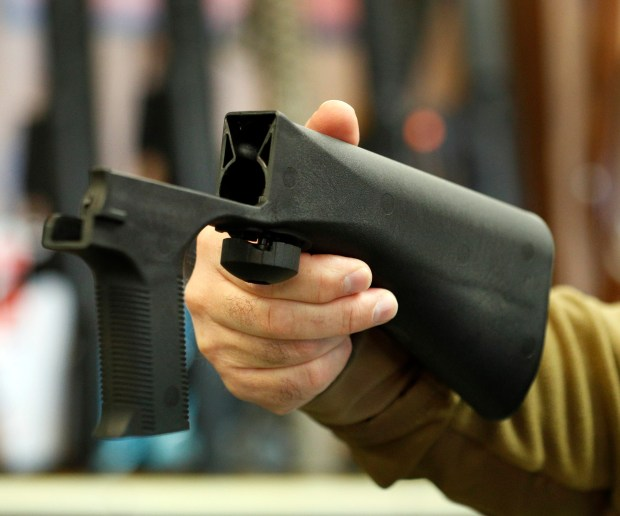 A bump stock device that fits on a semi-automatic rifle to increase the firing speed, making it similar to a fully automatic rifle, is shown at a Salt Lake City gun store on Thursday. Congress is talking about banning the device after it was reported to have been used in the Las Vegas shootings on Sunday.