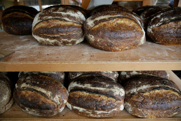 Freshly baked loaves of bread on a rack at the Tartine Manufactory in San Francisco. For a bread lover, no destination is more alluring than San Francisco.