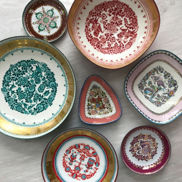 Interior designer Kirschner discovered one of these vintage Steinbock Enamel candy dishes at a flea market, then searched online for other pieces in the same series.