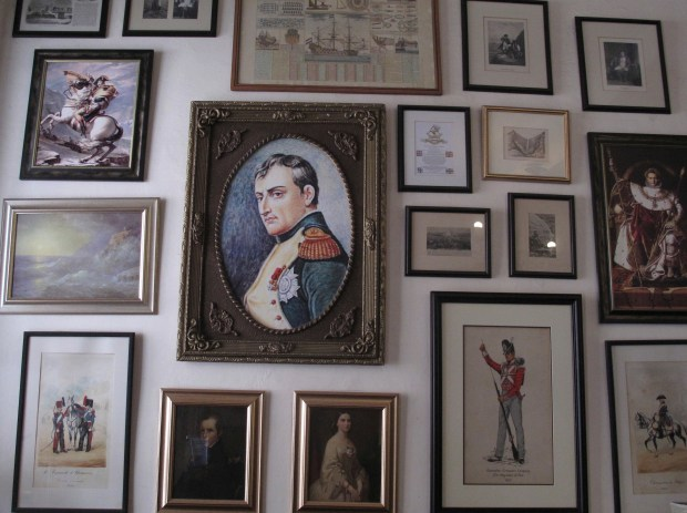 Several images of Napoleon Bonaparte are shown in this collection of framed pictures on a wall in the Consulate hotel in Jamestown on St. Helena island in the Atlantic Ocean. Napoleon was sent into exile there in 1815 and died on the island in 1821; the relatively few tourists who make it to remote St. Helena are likely to visit Longwood House, where the deposed French emperor died after an illness.