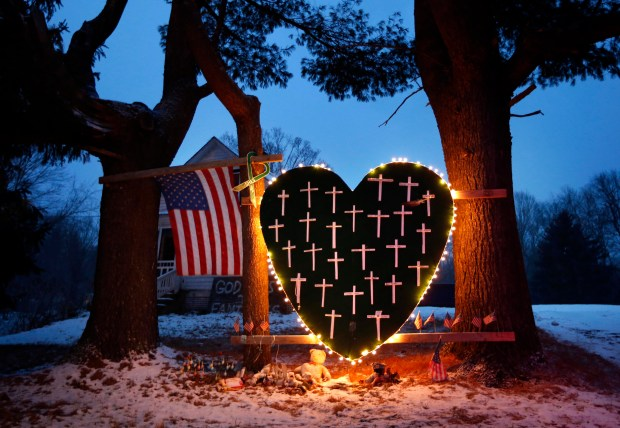 A makeshift memorial with crosses for the victims of the Sandy Hook massacre stands outside a home in Newtown, Conn., on Dec. 14, 2013, the one-year anniversary of the shootings.