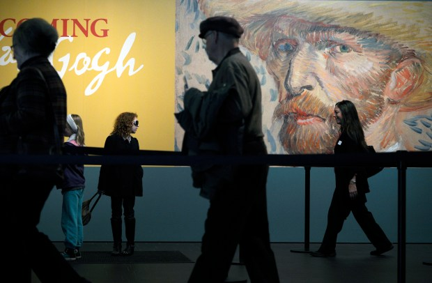 "Patrons wait in line to the ""Becoming Van Gogh"" exhibit at the Denver Art Museum on Dec. 30, 2012. Colorado nonprofits, including the DAM, received nearly $1 billion in publicly reported charitable gifts of $1 million or more between 2006 and 2017."