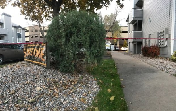 Police tape is seen at an apartment complex that was the scene of a fatal shooting near Colorado State University in Fort Collins early Thursday morning.