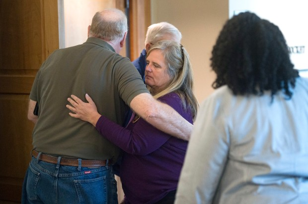 Ann Marie Doolittle, mother of Ashley Doolittle, receives a hug as she exits the courtroom after a verdict is read in the trial of Tanner Flores at the Larimer County Justice Center on Wednesday, October 4, 2017. Tanner Flores has been convicted for the murder of his ex-girlfriend, 18-year-old Ashley Doolittle, in June 2016.